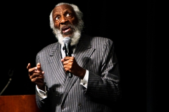Comedian and Civil Rights activist, Dick Gregory, speaks at Plachta Auditorium Tuesday night to a full audience as part of Black History Month.