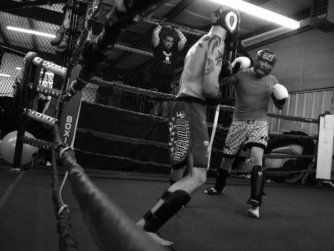 "Kyle ""the AK"" Kinney practices kick boxing against Bret ""The Spyder"" Sbardella during his workout at Elite Fitness in Mount Plesant. ""He sure doesn't go easy on you,"" said Kinney while taking a break after Sbardella delivered a hard blow to his leg."