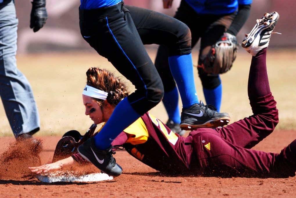 Junior outfielder Lauren Bowman slides into second base during the first game against Buffalo Friday afternoon at Margo Jonker Stadium. Central won 7-1.